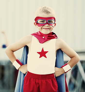 "Boy wearing superhero costume before his appointment with a children's dentist in Burlington, KY."" width=350 height=376 class="